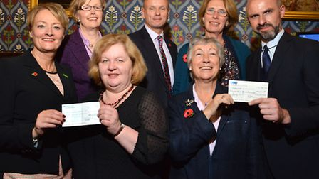 Back row from left Niamh O'Donnell-Keenan, Mike Freer MP and Susie Gregson. Front row from left Pam