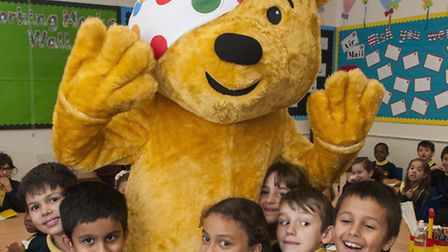 The 'real' Pudsey Bear with children at Garden Suburb Junior School to promote Children in Need Pict