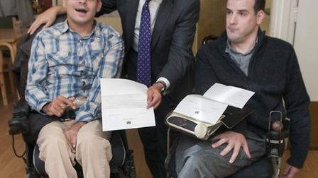 Mike Freer presents Matthew Kayne and Simon Davis with letters from David Cameron. Picture: Nigel Su