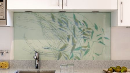 A fused glass splashback with Michèle Oberdieck's 'Spring Leaves' design