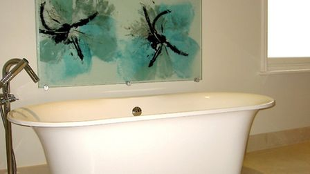 Aqua floral splashback in a bathroom