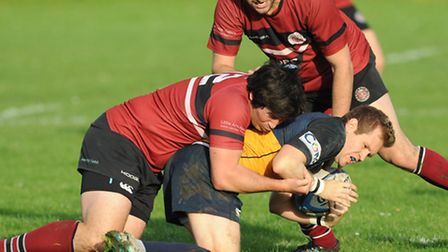 Hackney's Ed Clark (in green and yellow) in action against UCS Old Boys. Pic: Paolo Minoli