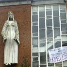 The convent building adorned with a banner erected by the squatters. Picture: Nigel Sutton.