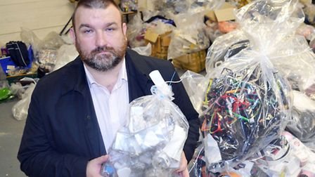 Cllr Jonathan Simpson, cabinet member for community safety, with some of the seized goods