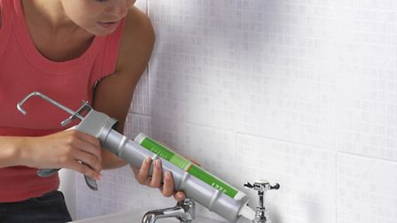 Applying sealant between a wall and a sink. PA Photo/thinkstockphotos