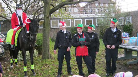 Father Christmas visits pupils at Kingsmead on horseback.