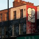 Stik's mural on the Georgian terrace houses in Dalston Lane.