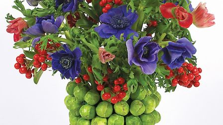 A brussel sprouts base topped with skimmia berries and anemones. PA Photo/Handout/Tobias Smith.