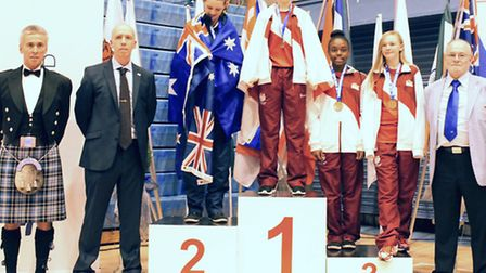 Chloe O'Sullivan Healy (centre) on the top of the podium at the Commonwealth Championships in Edinbu