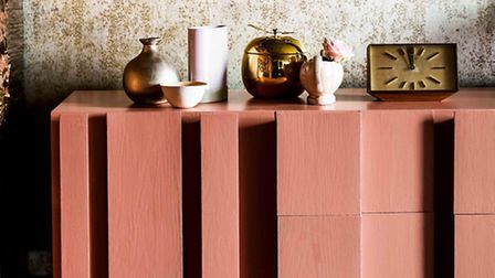 Copper blush seen on cabinet, complemented by copper accessories, Dulux. PA Photo/Handout