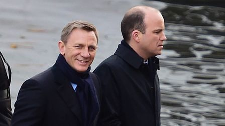 Rory Kinnear and Daniel Craig stand at the front of a speedboat on the canal in Camden, as they film