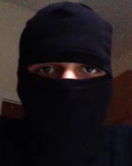 A still of Souaan with his face covered from video footage taken off his mobile phone.