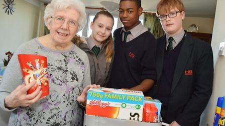 Denton Estate resident Eileen Bromwich, 77, and pupils Louise Warman, 13, Kayshen Azevedo, 13, and A