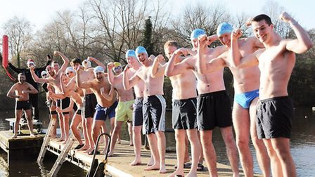 Male swimmers flex their muscles before their race. Picture: Dieter Perry