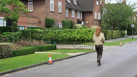 Emma Watson walking down Heathgate during filming of Harry Potter and the Deathly Hallows (part I)