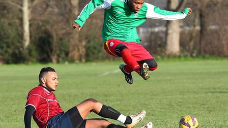 Action from the Jack Walpole Cup tie between FC Haggerston (burgundy/white) and London Meteors. Pic: