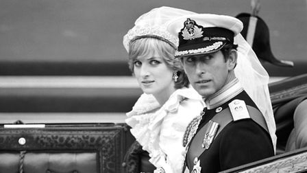The Prince and Princess of Wales in an open carriage, waiting to drive to Buckingham Palace after th