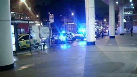 Police, ambulance and fire crews attend the scene after a man dies under a train at Finchley Road tu