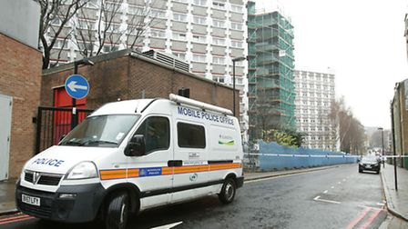 A police van outside Stelfox House in King's Cross where a murder investigation has been launched af