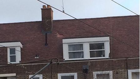 """?@twobuyfour tweeted: """"Damage to the roof of Nisbet House, #Homerton #E9. After last nights machete"""