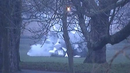 The controlled explosion in Clissold Park. CCTV image from Hackney Council