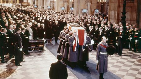 Borne by Guardsmen, the coffin of Sir Winston Churchill leaves St. Paul's Cathedral, London, after h
