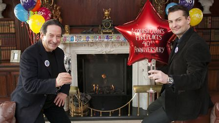 Ken Kennedy and son Jonathan Kennedy celebrate the 40th anniversary of Acquisitions Fireplaces. Pict