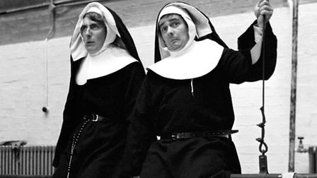"Comedians Peter Cook (L) and Dudley Moore rehearsing their ""Leaping Nuns"" sketch for Cook's Revue ""R"