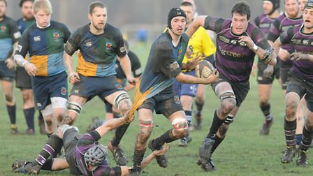 Hackney's Ben Chamberlain tried to shake off the tackle of Belsize Park's Tom House