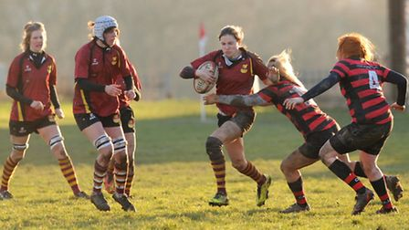 Lilly Hunt (centre) on the attack for Hampstead. Pic: Paolo Minoli