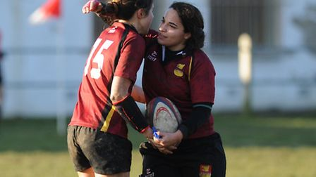 Fran Hall (right) congratulates Lilly Hunt on her opening try. Pic: Paolo Minoli