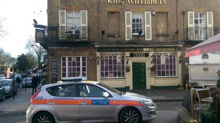 A police car stationed outside the King William IV pub in Hampstead last week following Suzie Wright