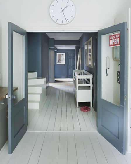 A west-facing hallway painted with Farrow and ball Slipper Satin