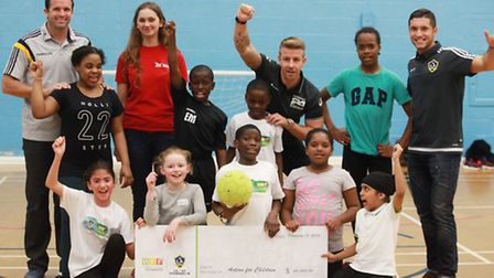 Action for Children charity receive a cheque by Herbalife Foundation and LA Galaxy football team