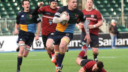 Hackney's Matt Strong races away to score his second try against UCS Old Boys at Saracens' Allianz P