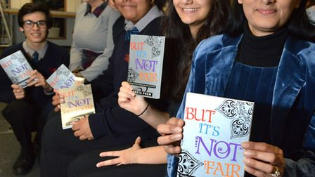 Aneeta Prem (front) with Year 11 pupils who put on a short play dealing with some of the issues rais