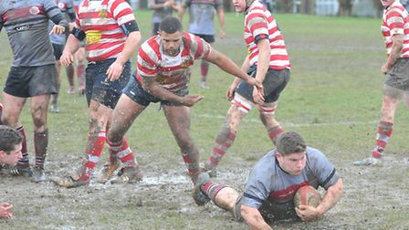 Prop David Myers touches down to open the scoring for UCS Old Boys against Finchley. Pic: Nick Cook/