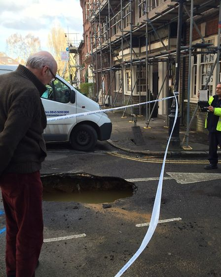 A burst water main seems to be the cause of this pothole in New End at the junction with Well Walk.