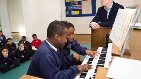 Pupils from Willow Tree class (year 5) of St John the Baptist Primary School take part in an organ w