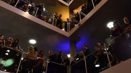 Pupils and guests watch the official opening by Helena Bonham Carter from the central landings. Pict