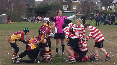 Hampstead's Under-12s (left) prepare to scrum down