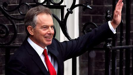 British Prime Minister Tony Blair, bids farewell during his last day in Downing Street.