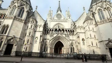 An internet campaign about a satanic cult operating at a Hampstead school was a 'fantasy' High Court