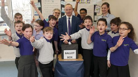 Mike Freer MP votes in Limespring School's mock election. Picture: Nigel Sutton