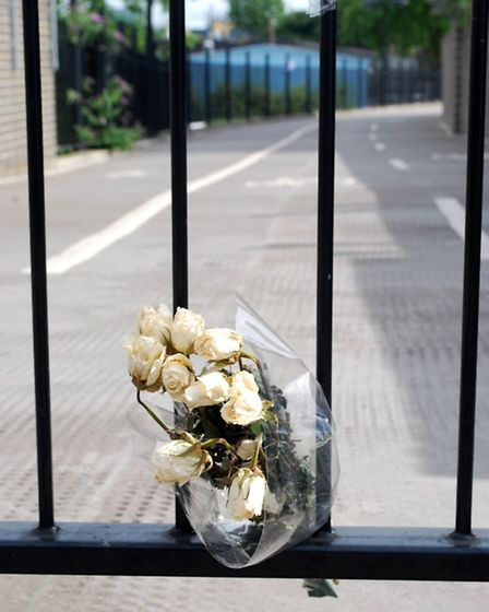 A bunch of flowers on the cycle path where the man was stopped by police. Picture: Polly Hancock