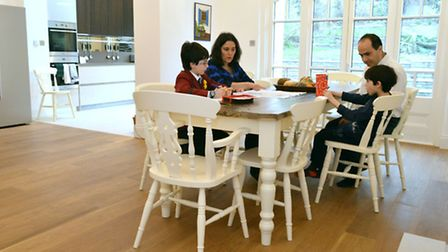 Max (10) with parents Tatiana and James Tanner and brother Daniel (7) at the re-claimed wood dining