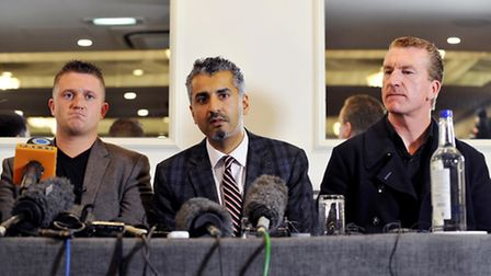 Left to right: Former EDL leader Tommy Robinson, Maajid Nawaz and EDL co-founder Kevin Carroll, duri