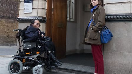 John Howard and Amy Gray outside Nat West, looking at a step which makes it impossible for a wheelch