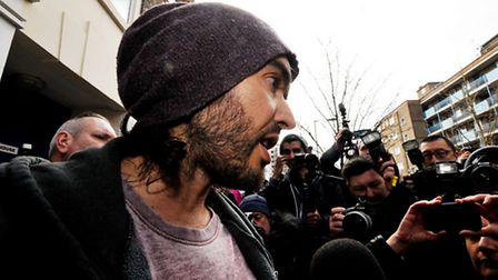 A media circus engulfs Russell Brand as he arrives to open the Trew Era cafe