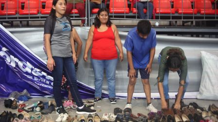 Mexican migrants from the caravan dividing America, assemble in a sports hall in Cordoba, South East